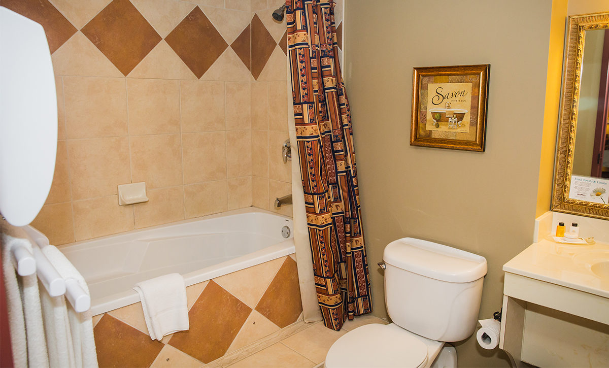 King Bathroom, with towel warmer and air-massage tub.