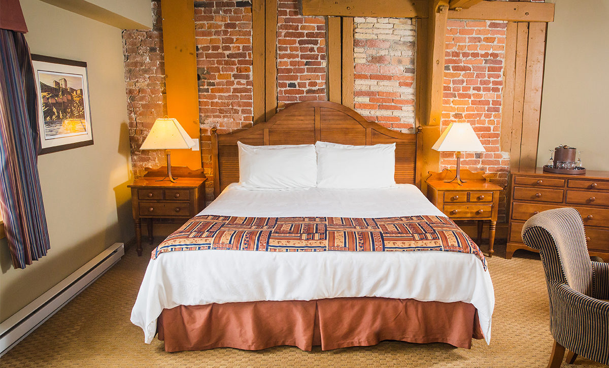 King Bed with exposed masonry walls in our King Executive Room